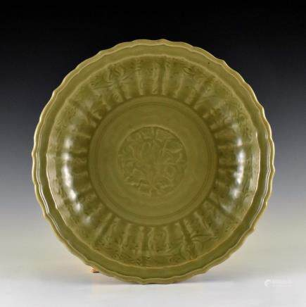 CARVED PEONY LONGQUAN CELADON BARBED-RIM CHARGER