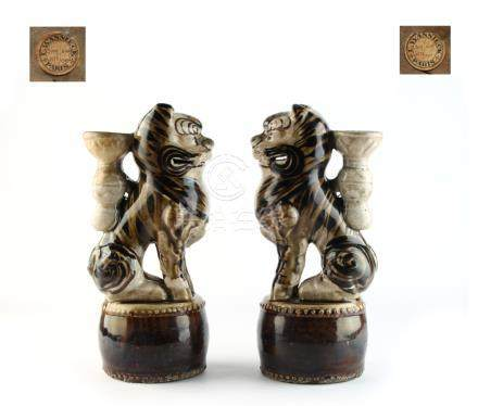 A pair of Chinese Cizhou type glazed pottery incense holders, Song / Ming Dynasty, each modelled