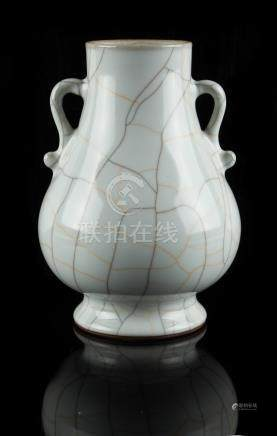 A Chinese guan type two-handled vase, hu, probably late 20th century, 7ins. (17.8cms.) high (see