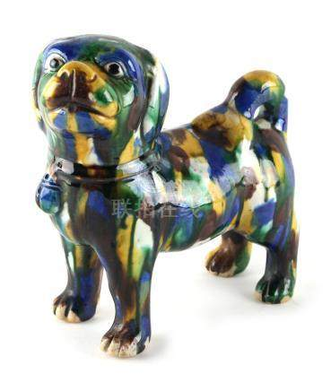 A Chinese 'egg and spinach' glazed model of a standing dog, with blue & brown splashes, 6.75ins. (