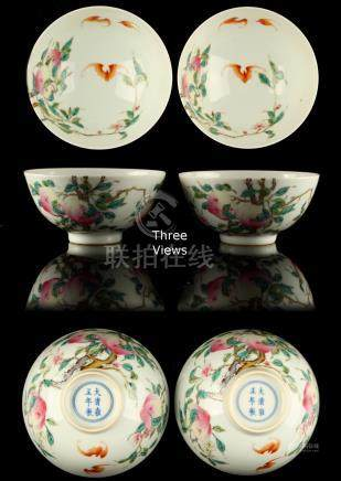 A pair of Chinese famille rose peaches & bats bowls, each with an underglaze blue Yongzheng 6-