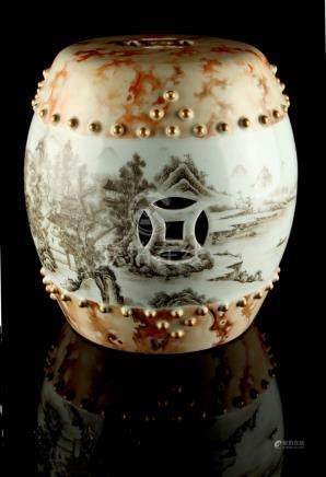 A small Chinese porcelain barrel seat, decorated en grisaille with a mountainous river landscape,