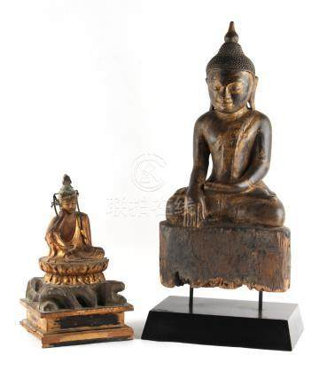 Property of a lady - a carved wood figure of a seated Buddha, mounted on a modern black stand, 19.