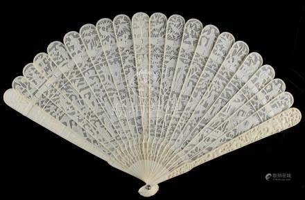 A Chinese Canton carved ivory fan, 19th century, 7.5ins. (19.1cms.) long (see illustration).