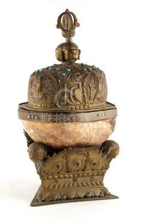 Property of a deceased estate - a 19th century Tibetan brass mounted human skull bowl, kapala, the