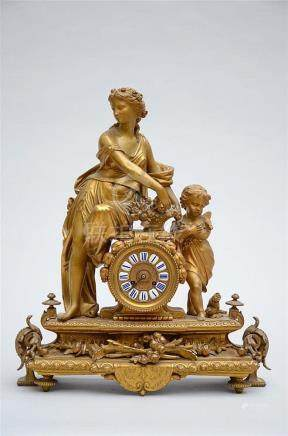 Clock in gilt zamac 'Woman with putto' (52x62cm)