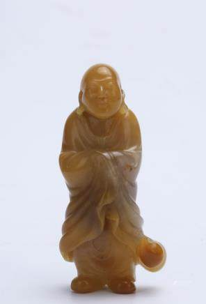 A Chinese Carved Yellow Jade Buddha