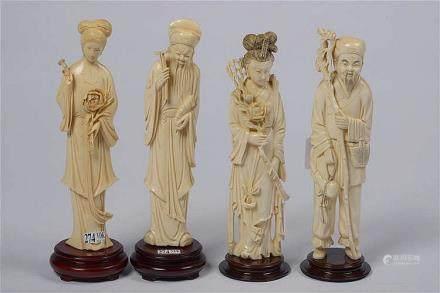 """Lot comprenant quatre sculptures en ivoire dont deux """"Guanyi"""